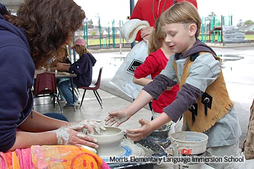 Photo of a student throwing pottery at Exploration Day.